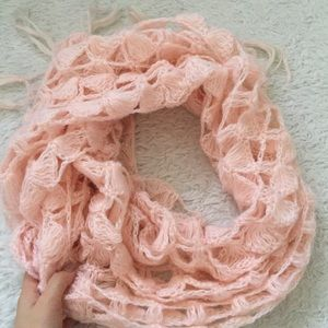 Long pink knitted scarf